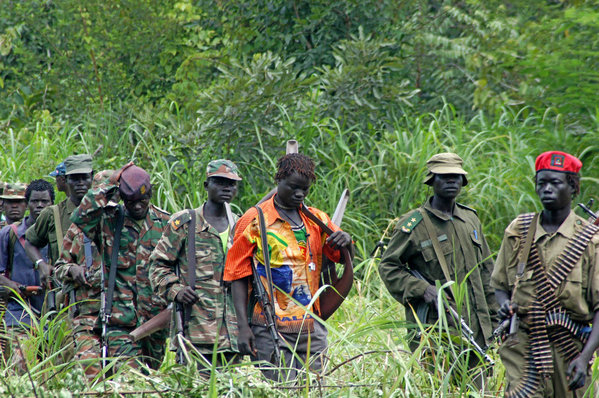 FILE - In this July 31, 2006 file photo, members of Uganda's Lord's Resistance Army (LRA) are seen as their leader Joseph Kony meets with a delegation of Ugandan officials and lawmakers and representatives from non-governmental organizations, in the Democratic Republic of Congo near the Sudanese border. The LRA Crisis Tracker group which tracks the Joseph Kony-led LRA said in a report released Thursday, Feb. 7, 2013 that the LRA killed 51 civilians across Central Africa in 2012, a huge drop in the number killed from two years previous. (AP Photo, File)