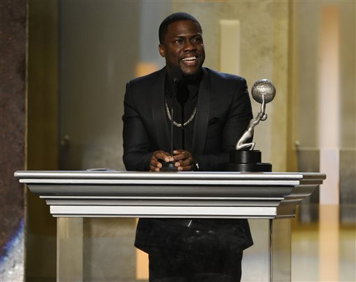 Kevin Hart accepts the award for entertainer of the year at the 45th NAACP Image Awards at the Pasadena Civic Auditorium on Saturday, Feb. 22, 2014, in Pasadena, Calif. (Photo by Chris Pizzello/Invision/AP)