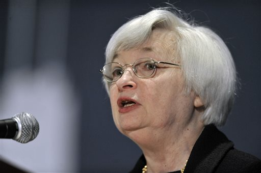 In this March 31, 2014 file photo, Federal Reserve Chair Janet Yellen speaks to community development professionals at the National Interagency Community Reinvestment Conference in Chicago. Yellen said Tuesday, April 15, 2014 that the largest U.S. banks might need to hold additional capital to withstand periods of financial stress. (AP Photo/Paul Beaty, File)