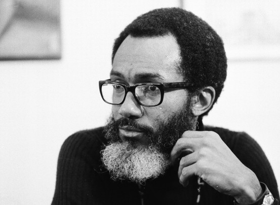 """Poet and novelist Sam Greenlee in 1973. His movie, """"The Spook Who Sat by the Door,"""" based on his book by the same name, became a classic in the black nationalist movement. (AP Photo)"""