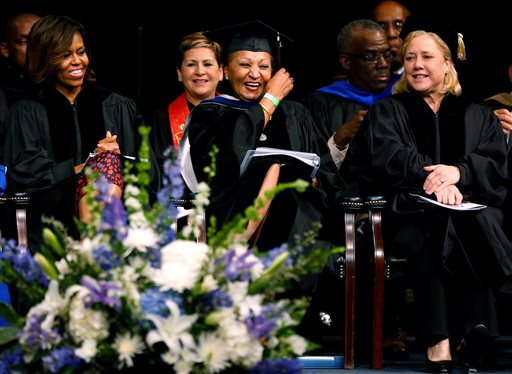 First lady Michelle Obama, left, Dillard's chair of the board of trustees Joyce M. Roche, center, and Sen. Mary L. Landrieu (D-La.) share a moment during Dillard University's commencement ceremony in New Orleans, Saturday, May 10, 2014. (AP Photo/Jonathan Bachman)