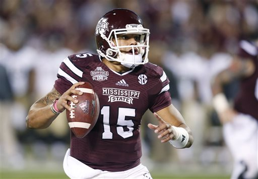 Mississippi State quarterback Dak Prescott looks for an open receiver in the first half of an NCAA college football game against Vanderbilt on Saturday, Nov. 22, 2014, in Starkville, Miss. No. 4 Mississippi State won 51-0. (AP Photo/Rogelio V. Solis)