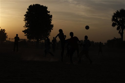 Internally displaced children who fled their homes with their families following an attack by Islamist militants in North East, Nigeria, run round a soccer ground at a camp in Yola, Nigeria, Friday Nov. 28, 2014.  Some thousands of people have fled their homes in recent times due to Boko Haram attacks. (AP Photo/Sunday Alamba )