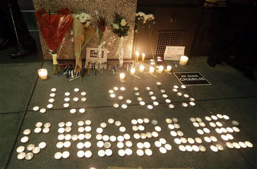 "The words ""I am Charlie"" are spelled out with candles at a gathering in solidarity with those killed in an attack at the Paris offices of the weekly newspaper Charlie Hebdo on Wednesday, Jan. 7, 2015,  outside the French Consulate in San Francisco. (AP Photo/Marcio Jose Sanchez)"