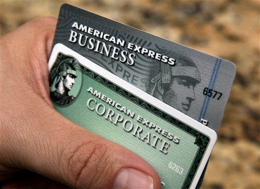 In this Jan. 20, 2010 file photo, American Express cards are posed for a photograph in Phoenix. Amex's stock is down 11 percent this year, making it the second-biggest decliner on the Dow Jones industrial average. (AP Photo/Ross D. Franklin, File)