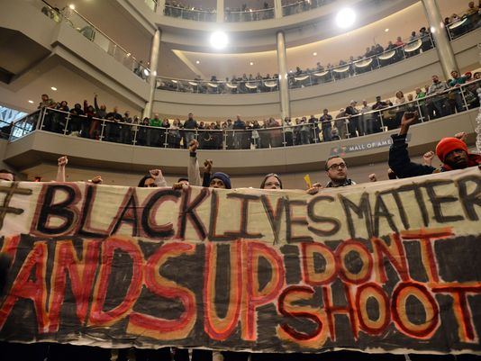 """Demonstrators filled the Mall of America rotunda and chanted """"black lives matter"""" to protest police brutality, Saturday, Dec. 12, 2014, in Bloomington, Minnesota. In Wausau, church leaders are planning a Black Lives Matter march which they've also called a march to """"stand against racism."""" (Photo: AP Photo/The Star Tribune, Aaron Lavinsky)"""