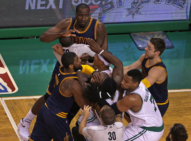 After taking a hard foul from Cleveland Cavaliers center Kendrick Perkins (3), Boston Celtics forward Jae Crowder (99) is separated from Perkins teammates and floor official late in second quarter of a first-round NBA playoff basketball game in Boston on Sunday. Crowder was involved in two physical plays during the game. First, he was shoved by Perkins and both drew technical fouls. Then he left the game with a sprained left knee when he was knocked down as J.R. Smith swung his arm backward while jostling for a rebound early in the third quarter. (AP/Barry Chin)