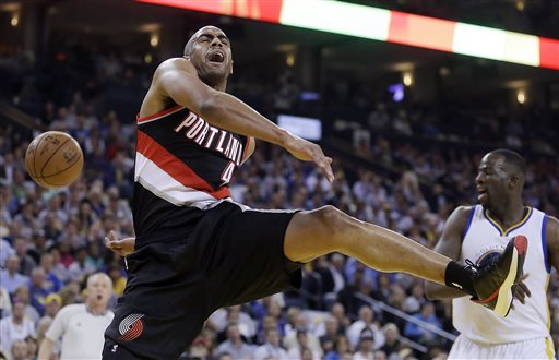 Portland Trail Blazers' Arron Afflalo, left, has his shot blocked by Golden State Warriors' Draymond Green during the first half of an NBA basketball game Thursday, April 9, 2015, in Oakland, Calif. (AP Photo/Ben Margot)
