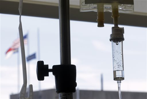 In this Sept. 5, 2013 file photo, chemotherapy is administered to a cancer patient via intravenous drip at a hospital in Durham, N.C. A leading doctor group, the American Society of Clinical Oncology, announced on Monday, June 22, 2015, that they are proposing a tool to help patients decide how much a drug will cost and how much good it is likely to do. The move is the latest of several recent efforts to focus on value in cancer care. (AP Photo/Gerry Broome, File)
