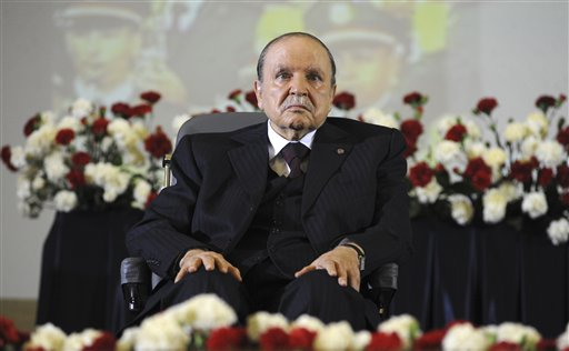 In this April 28, 2014 file photo, Algerian President Abdelaziz Bouteflika, sitting in a wheelchair, listens after taking the presidential oath in Algiers. Algeria is in the grips of political intrigue, as the president nears death and rumors of coup attempts swirl. Now, the unprecedented firing of three top generals is generating fear that a power struggle within the regime will break into the open - unleashing a new cycle of the bloodshed that plagued the country in the 1990s. (AP Photo/Sidali Djarboub, File)