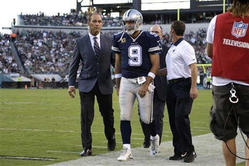 Dallas Cowboys' Tony Romo is helped off the field after an injury during the second half of an NFL football game against the Philadelphia Eagles, Sunday, Sept. 20, 2015, in Philadelphia. (AP Photo/Matt Rourke)