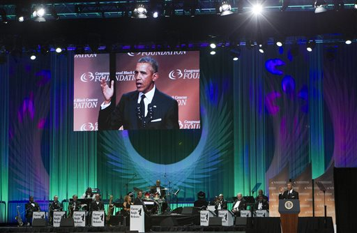 """President Barack Obama speaks at the Congressional Black Caucus Foundation's 45th Annual Legislative Conference Phoenix Awards Dinner at the Walter E. Washington Convention Center in Washington, Saturday, Sept. 19, 2015, about black women's role in helping shape American democracy, calling them """"the thinkers and the doers"""" who made things happen at the height of the civil rights movement half a century ago. ( AP Photo/Jose Luis Magana)"""