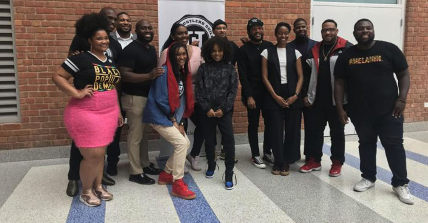 """The Hustler's Guild team and panelists after the panel, """"State of the Culture: Tech in Hip Hop & Mental Health in the Black youth community"""" at Roosevelt High School in Northwest, D.C. (Courtesy Photo)"""