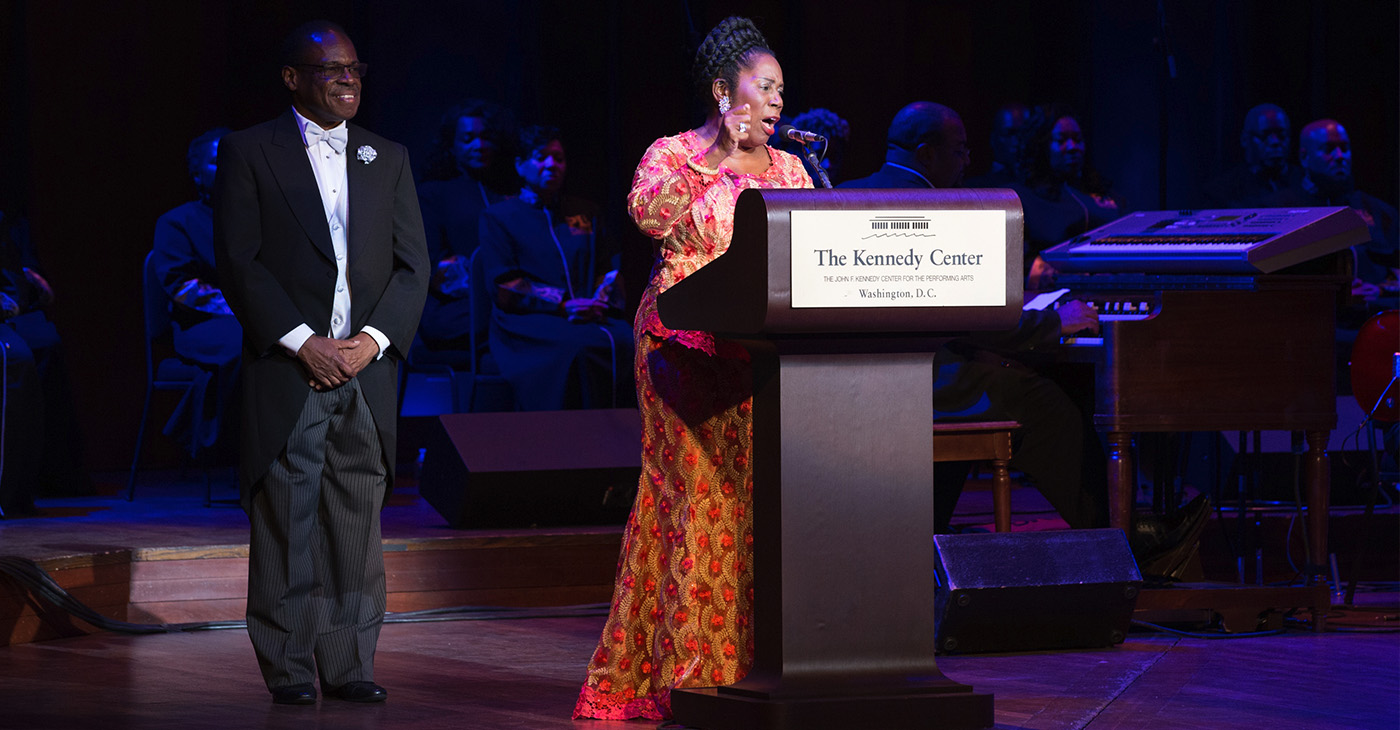 Gospel Music Advocate and Gospel Music Heritage Month Foundation Chairman Carl Davis with Congresswoman Sheila Jackson Lee (D-TX) on stage at the 2018 Evolution of Gospel Tribute to Aretha Franklin at the Kennedy Center for the Performing Arts (Photo by Brian Stukes)