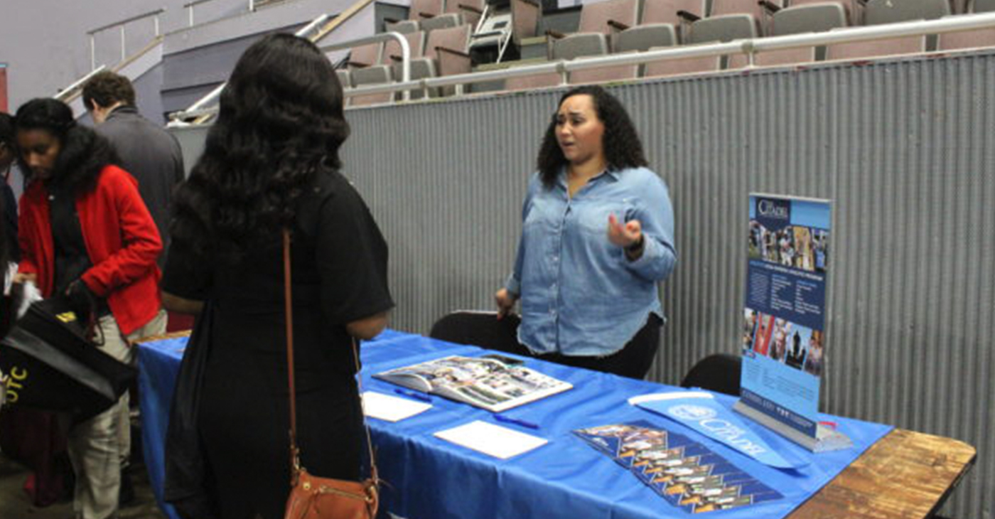 Lieutenant Teisha Neitz, admissions officer, The Citadel in Charleston, S.C. speaks with student during college fair. (Ameera Steward Photo, The Birmingham Times)