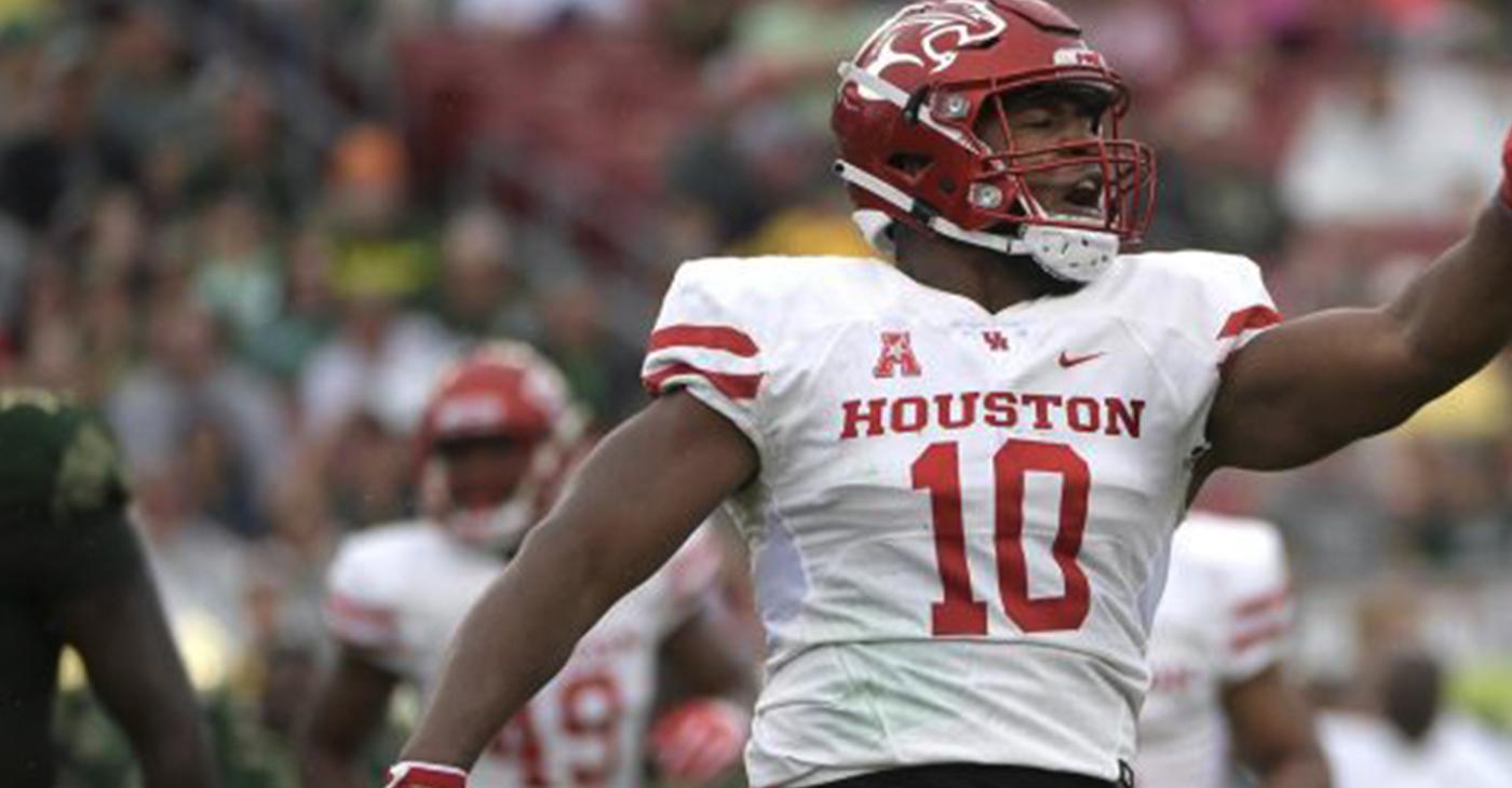 Houston defensive tackle Ed Oliver (10) celebrates after making a stop during the first half of an NCAA college football game against South Florida Saturday, Oct. 28, 2017, in Tampa, Fla. (Photo by Phelan M. Ebenhack)