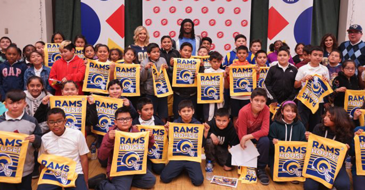 Rams' cheerleaders, Rams' running back Todd Gurley, Worthington Elementary School students and the school principal pose for a group photo at Gurley's Childhood Literacy Initiative event in Inglewood, Calif. (Lauren A. Jones/L.A. Sentinel)