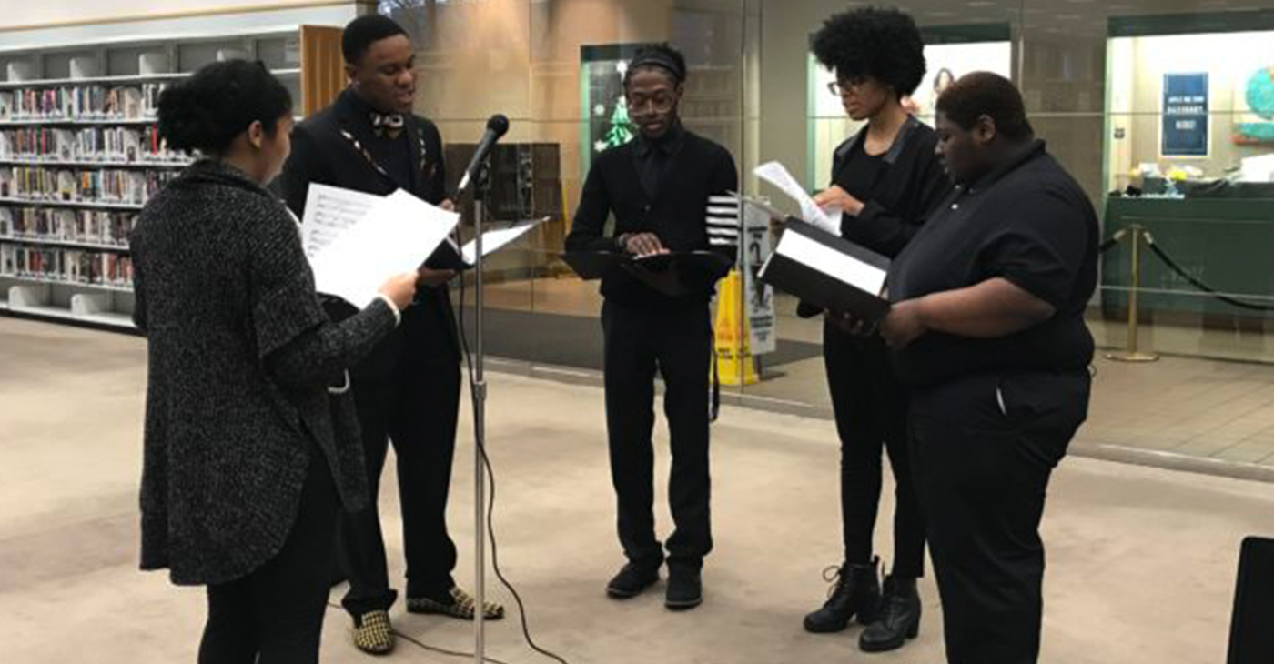 """The Lawson State Community College Choir quartet performed Christmas songs at the Birmingham Public Library, Central Branch on Sunday, Dec. 16, 2018. The quartet performed Christmas favorites like """"Silent Night,"""" """"Go Tell it on the Mountain,"""" """"Joy to the World,"""" """"Have Yourself a Merry Little Christmas"""" and """"The Christmas Song."""" The quartet was directed by Dr. Jillian Johnson, music professor at Lawson State and included students (from left) Jemanuel Pullom, Javaris Williams, BreAna Doss and Kayla King."""
