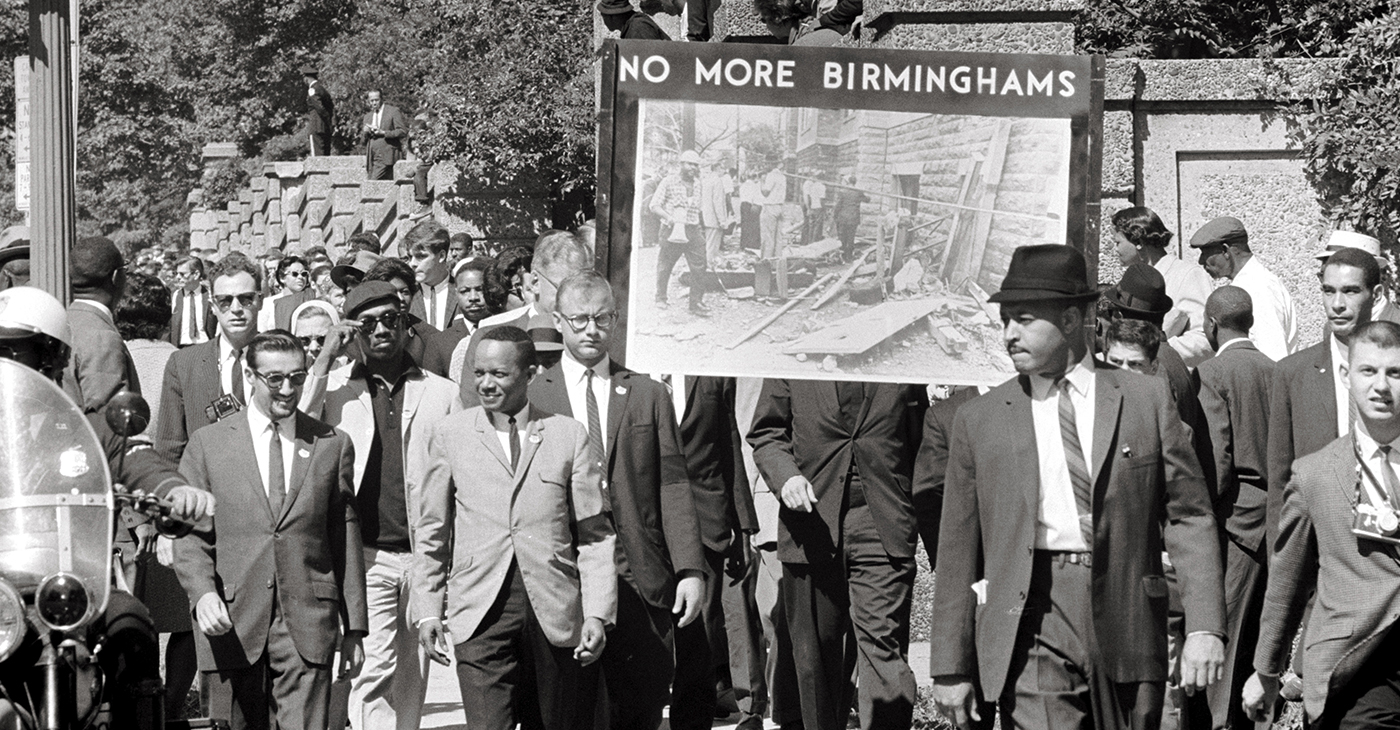 """Congress of Racial Equality and members of the All Souls Church, Unitarian located in Washington, D.C. march in memory of the 16th Street Baptist Church bombing victims. The banner, which says """"No more Birminghams"""", shows a picture of the aftermath of the bombing. (Photo: US News & World Report Collection, US Library of Congress / Wikimedia Commons)"""
