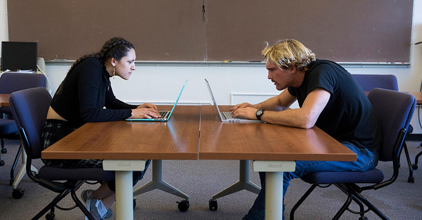 Students Brooke Rapko and John Chetwynd demonstrate poor computer posture.