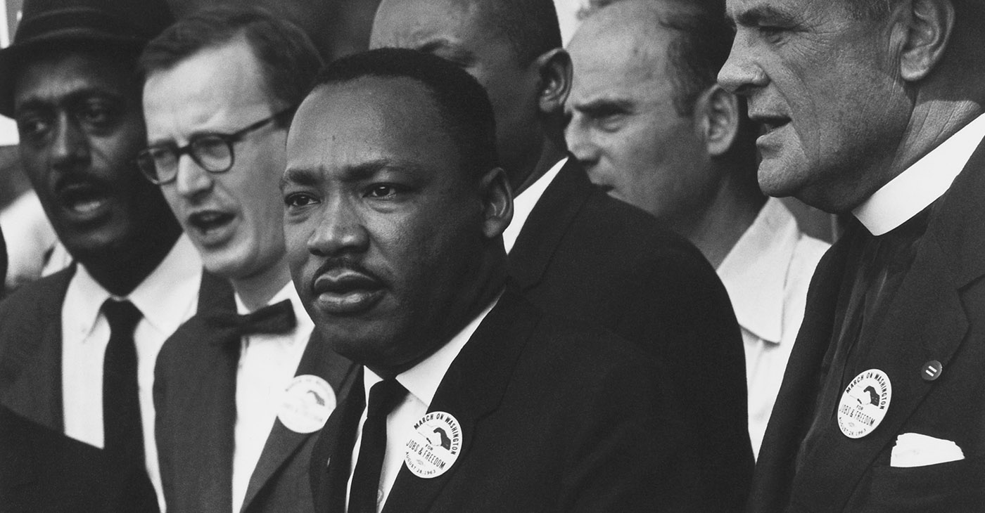 Dr. Martin Luther King, Jr. and Mathew Ahmann in a crowd. Civil Rights March on Washington, D.C., U.S. Information Agency. Press and Publications Service. Source: National Archives at College Park, Wikimedia Commons