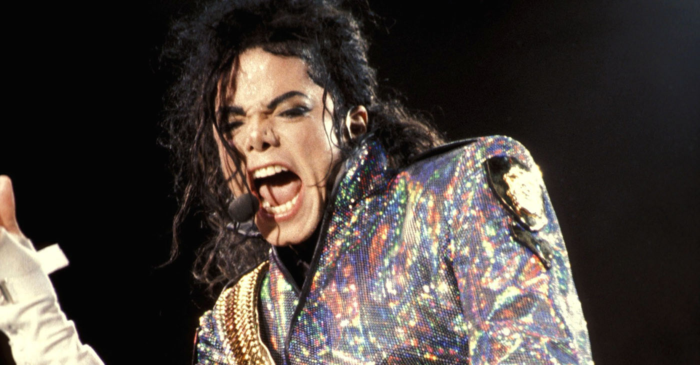 """As for Jackson, the late hitmaker often publicly said he simply enjoyed the company of children because of their innocence. """"I'd slit my wrist before I'd hurt a child,"""" Jackson once said in a broadcast interview. (Photo: The artist Michael Jackson performing his song """"Jam"""" as part of his Dangerous world tour in Europe in 1992. Source: Wikimedia Commons.)"""