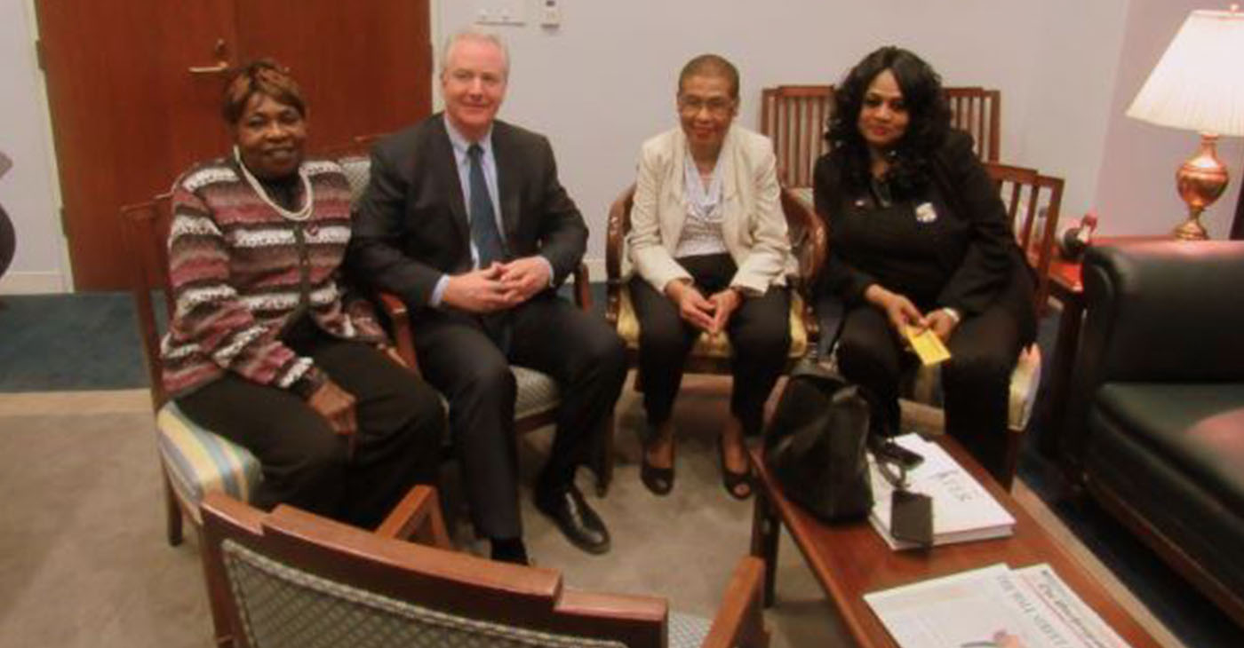 Government contractors and representatives of 32BJ-SEIU Lila Johnson (far left) and Faye Smith (far right), with politicians Sen. Chris Van Hollen (D-MD) and Rep. Eleanor Holmes Norton (D-D.C.).(Photo by: The Afro)