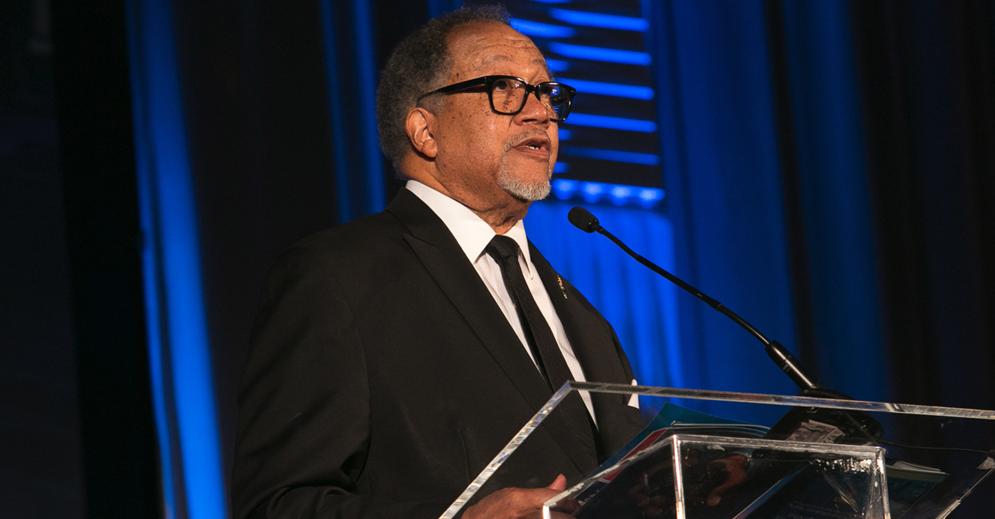 Chavis said the National Newspaper Publishers Association (NNPA) and its 215-member newspaper and media companies reach more than 22 million weekly subscribers and millions more daily via Blackpressusa.com and NNPA member websites. (Dr. Benjamin F. Chavis Jr. presents the NNPA's Lifetime Achievement Award during the recent NNPA's Mid-Winter Conference – Photo: Mark A. Mahoney / NNPA)