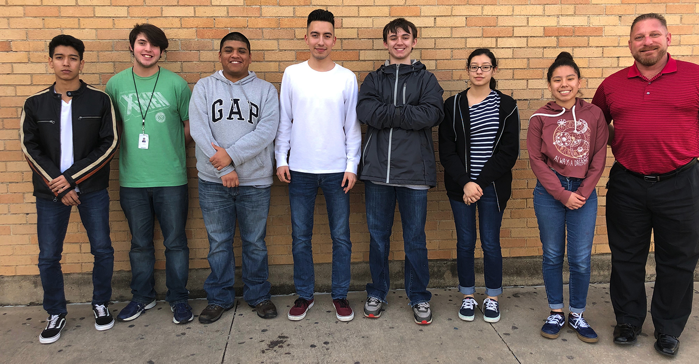 Irving High School Aviation Science students include: (From left to right) Gabriel Sanchez (senior), Caleb Fancher (junior), Javier Ramirez (senior), Jason Bernal (senior), Anthony Stahl (junior), Erika Gamboa (junior), Angie Maravi Campos (junior) and Craig Heckel (sponsor and the program's coordinator), are from Irving High School's aviation science who worked on the Real Life Design Challenge. (Photo credit: Irving Independent School District)