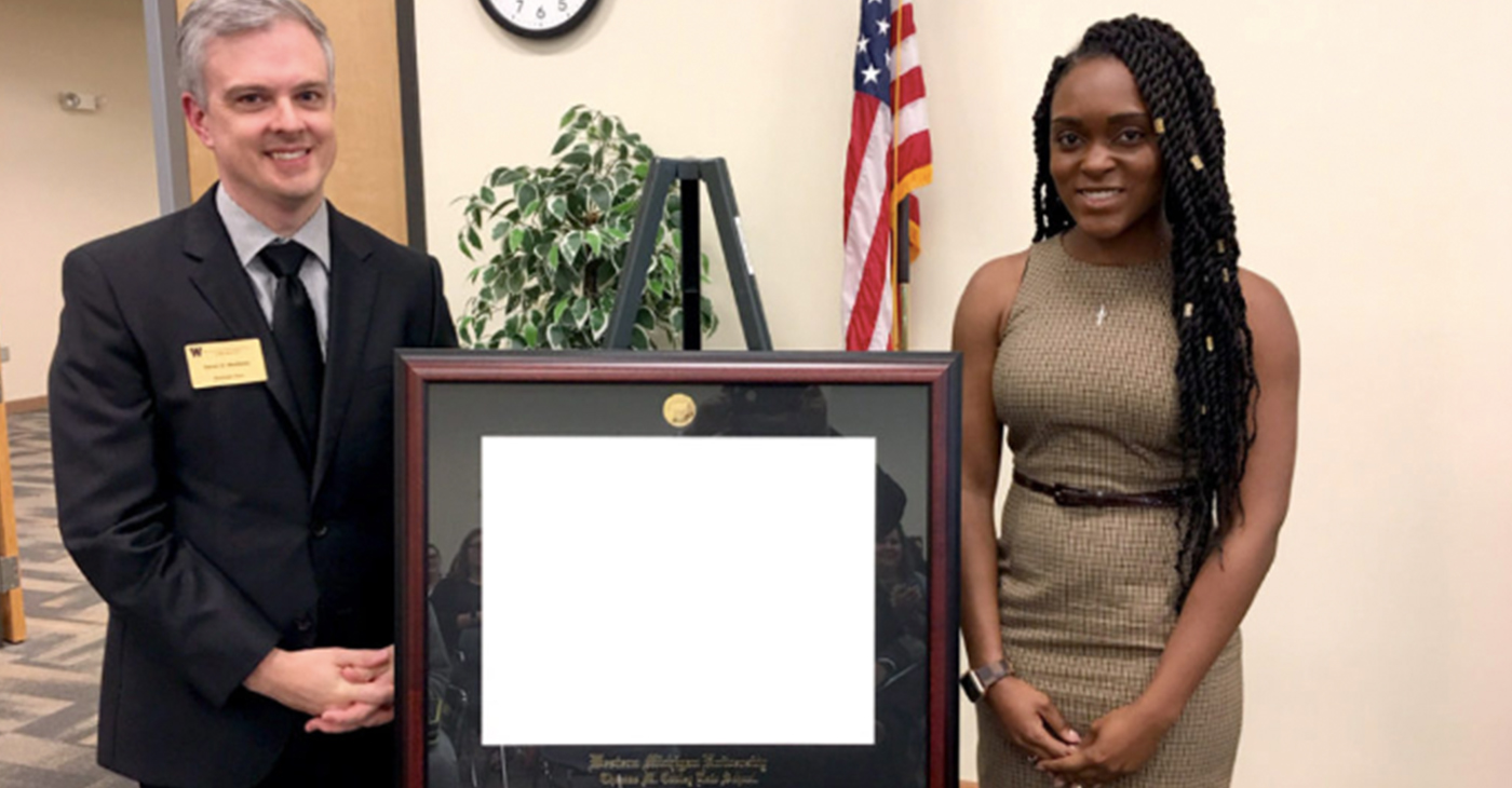 Ayana Clark is shown with Daniel W. Matthews, associate dean of WMU-Cooley Tampa Bay campus.