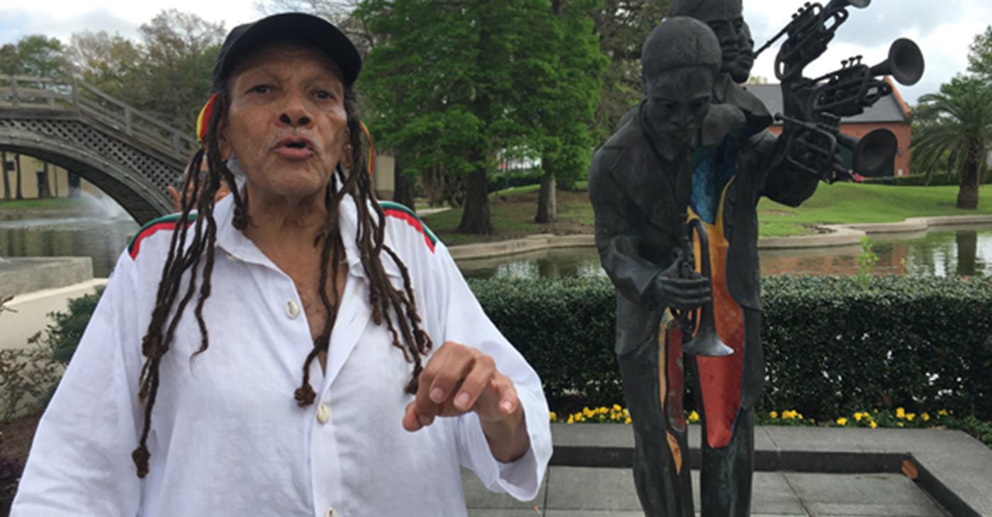 Tour guide Sakura Konē explaining the history of Buddy Bolden's statue
