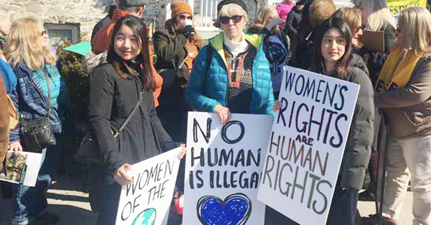 Women and men gathered on a Saturday to fight for women's rights outside of Elting Memorial Library in New Paltz on the day after International Women's Day.