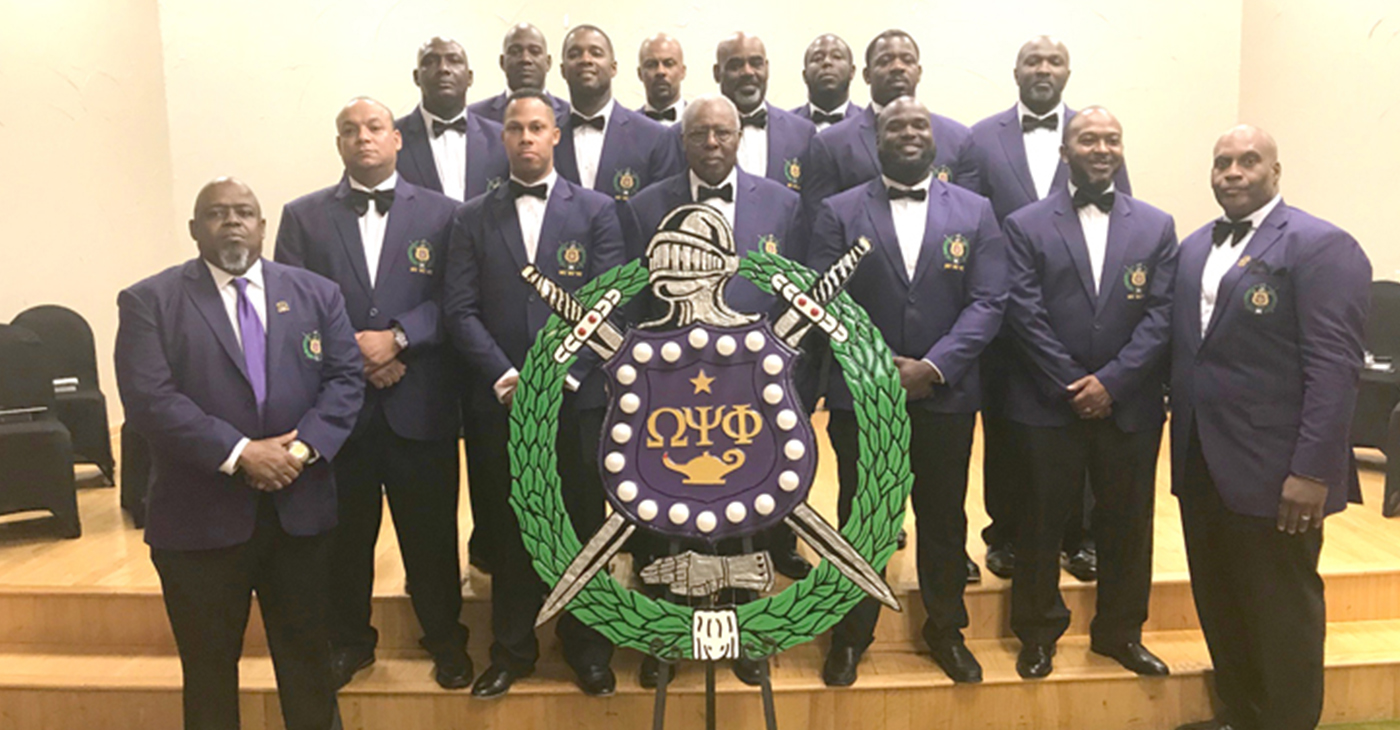 """ABOVE: The """"Mighty Majestic Noble 14"""" Charter Line (2019) of the Mu Mu Nu Chapter of Omega Psi Phi Fraternity, Inc., with Mu Mu Nu Chapter Basileus Bro. Charles Hopkins and Bro. John Barker"""