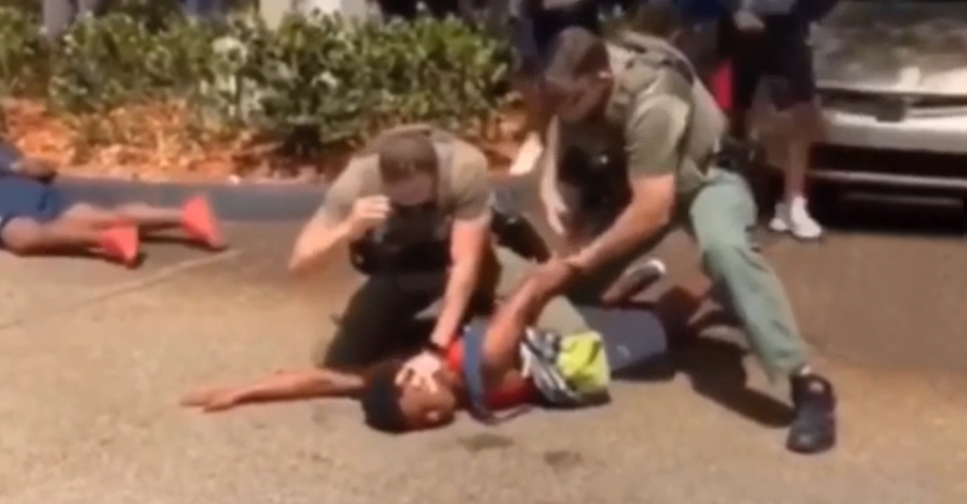 A cell phone video captured Broward County Sheriff's deputies pepper-spraying, tackling and punching a group of teens last week outside a McDonald's near the school.