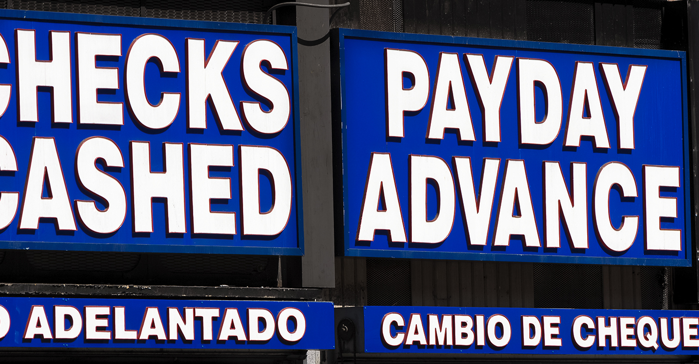 With the average borrower earning $25,000 to $30,000 a year, whatever difficulty led them to a payday loan store or web site, made their lives even worse. (Photo: iStockphoto / NNPA)