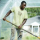 Farm Manager Adrian Mack Jr. building a raised bed (Bridget Besaw photographer)