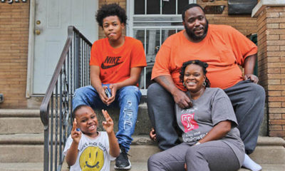 Janel Turner, (bottom right), her husband, and two of her sons, at their home in Philadelphia's Nicetown neighborhood. (Kimberly Paynter/WHYY)