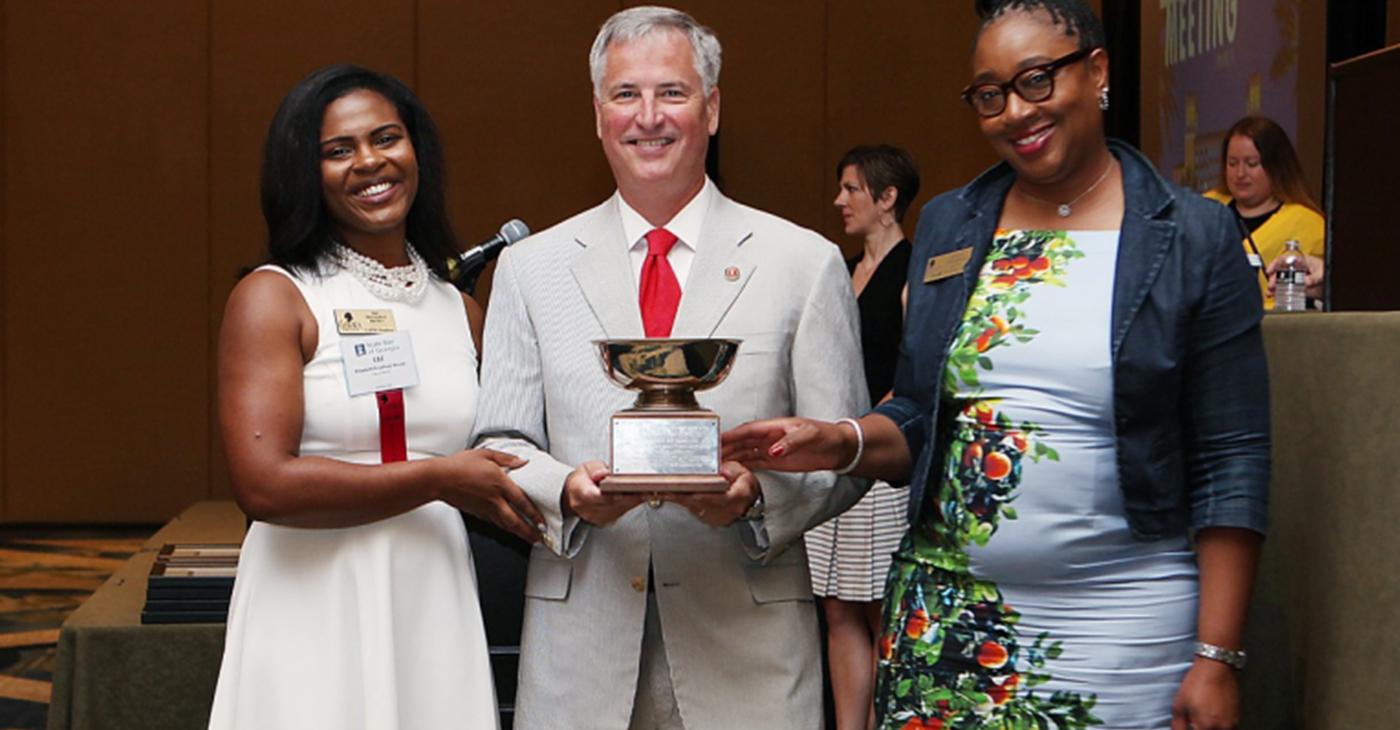 PHOTO: GABWA President Liz Brown (L) and Past President Rita M. Treadwell accept the President's Cup from 2018-19 State Bar of Georgia President Kenneth B. Hodges III. (Photo by Sarah Coole/State Bar of Georgia)