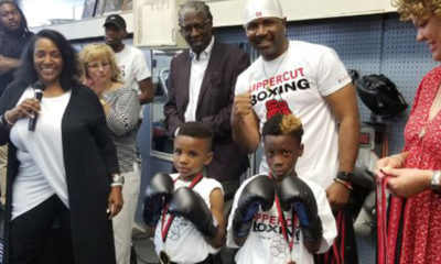 """Pictured from left to right: Thunder Robinson, Uppercut's owner, Marcus Pollock, executive director of Park Heights Renaissance, Coach Leon """"The Truth"""" Wallace, Baltimore City Councilwoman Sharon Green-Middleton, in front are boxers Emmanuel Hibbert and Jalon Hall. (Courtesy Photo)"""
