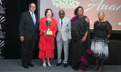 Brenda Andrews of the New Journal and Guide newspaper in Norfolk, Va., who hosted last year's convention, was greeted with a standing ovation as she ascended the platform to accept the NNPA Publisher of the Year Award. (Pictured left to right: Dr. Benjamin F. Chavis, Jr., NNPA President and CEO; Brenda Andrews publisher of the New Journal and Guide; Karl Rodney, NNPAF board member and publisher of the New York Carib News; Amelia Ashley-Ward, NNPAF board chairman and publisher of the San Francisco Sun Reporter; Dorothy Leavell, NNPA board chairman and publisher of the Chicago and Gary Crusader Newspapers. Photo: Mark Mahoney/Dream In Color Photography for NNPA)