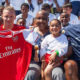 Inglewood mayor James Butts (center) poses with Rams rookie Jalen Greene (right) and Arsenal FC Goalie Bernd Leno (left) (Photo by: Larry Salazar/T.G. Sportstv1)