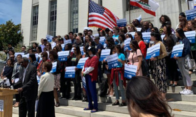 "Standing on the steps of the Alameda County Superior Courthouse, dozens of people chant ""Our Community Counts! Our Community Belongs!"" followed by speeches from immigrant advocates, elected officials, and allies, Thursday, June 27. Photo courtesy of Alameda County Census."
