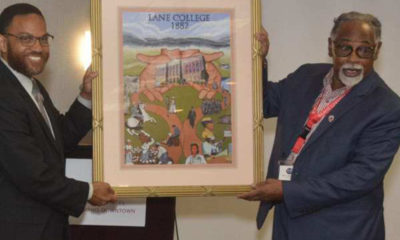 Lane College President Logan Hampton (left) and the Rev. Dr. L. LaSimba M. Gray Jr., a Lane College alum, display a framed image that reflects the Lane College historical journey. (Photo: Tyrone P. Easley)