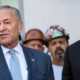 Sens. Chuck Schumer and Cory Booker (Courtesy photo/AM New York)