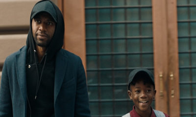 """The Look"" follows a Black man throughout his day as he encounters a variety of 'looks' that symbolize a barrier to acceptance. In the film, the windows of a passing car are raised after his son waves to a young girl in the back seat. (Photo: Business Wire)"