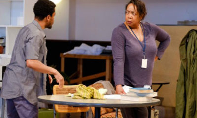 Jon Michael Hill as Austin and Jacqueline Williams as Mom have a frank discussion during a scene from the hallmark play True West, which was Steppenwolf's original production that opened in 1982 with then fairly unknown actors Jeff Perry (Austin) and John Malkovich (Lee) playing the leads, alongside ensemble members Francis Guinan and Laurie Metcalf. (Photo provided by Steppenwolf Theatre).