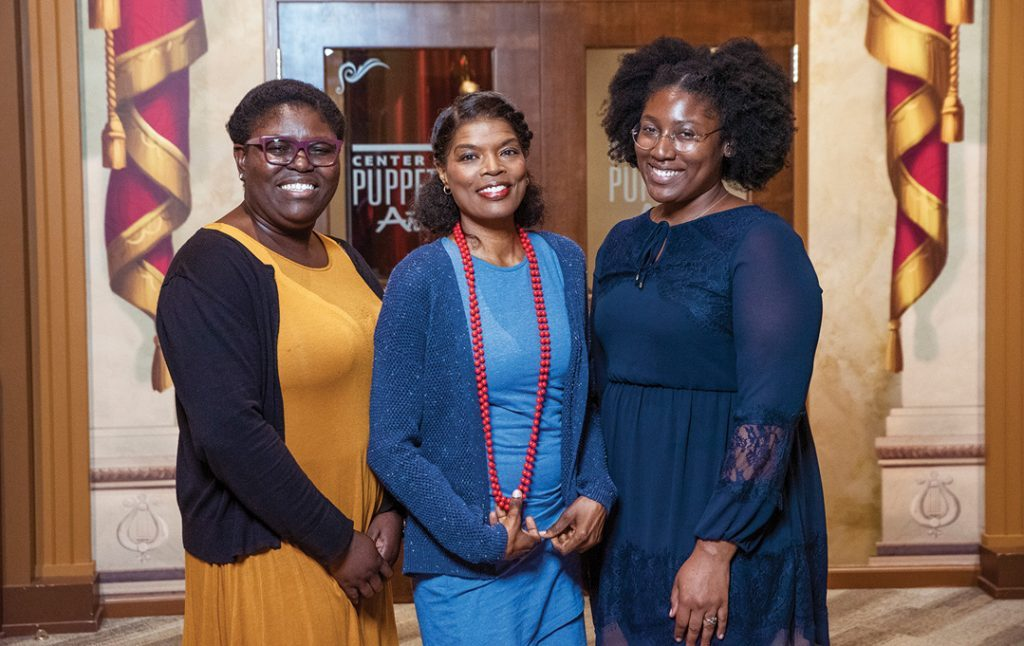 (Left to right) Education coordinator Liz Fagbile, teaching artist Paulette Richards and collections manager Yanique Leonard are a few creative staff members helping to tell puppetry stories in Atlanta. (Photo: Reginald Duncan / The Atlanta Voice)