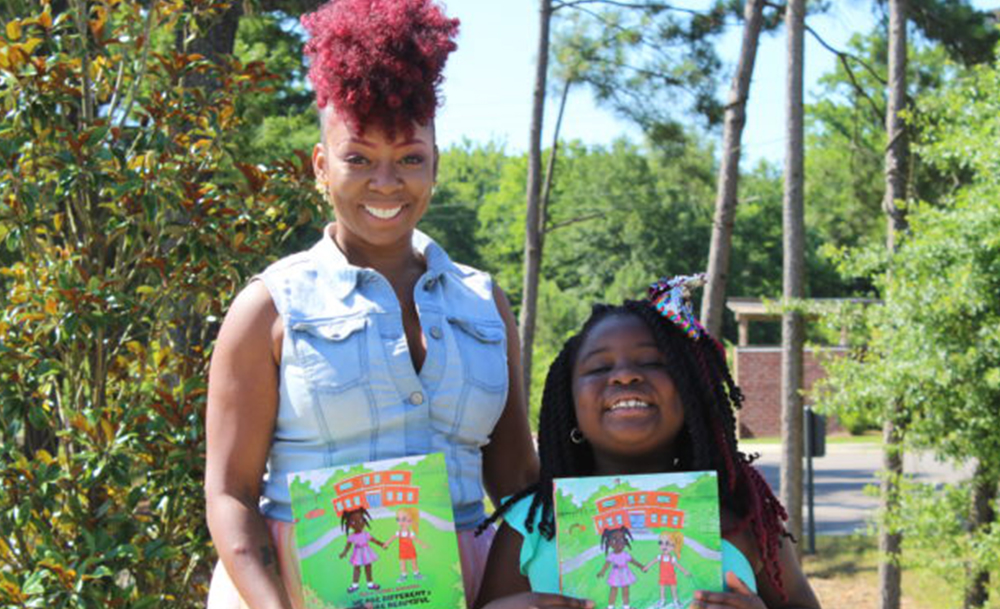 "Dee (left) and Aubrey Edwards with their book ""We Are Different & We Are Beautiful"" (Ameera Steward, The Birmingham Times)"