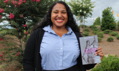 "Neena Speer with her book ""Dear Future Lawyer: An Intimate Survival Guide for the Minority Female Law Student"" (Photo by: Ameera Steward 