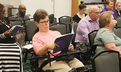 Rhonda Clark, a frequent user of WeGo's on-demand service, reading the meeting agenda and studying the proposed changes MTA board approved last week.